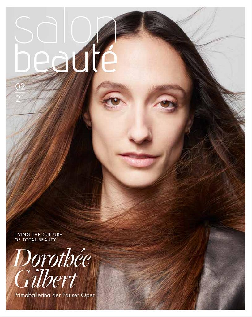 Titelseite: Eine Frau mit offenem braunem Haar